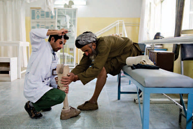 Man learning about his prosthetic leg from a medical professional section image